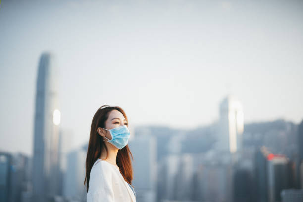Young Asian woman wearing a protective face mask to prevent the spread of coronavirus, a global health emergency over outbreak