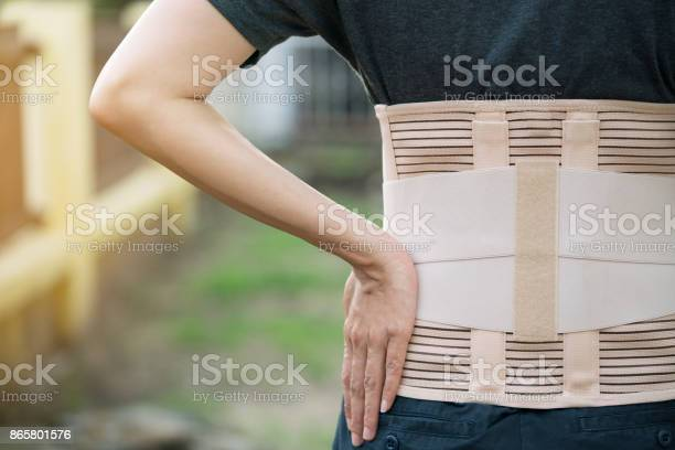 Young Asian Woman Wearing Back Support For Protect Her Back Medicine And Healthy Concept Stock Photo - Download Image Now