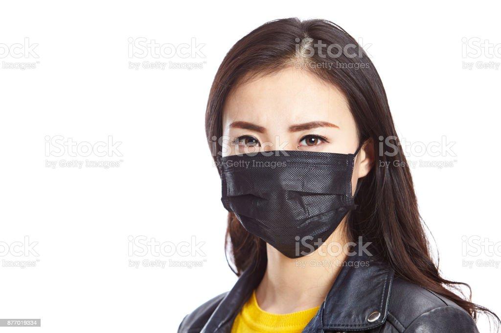 young asian woman wearing black mask stock photo