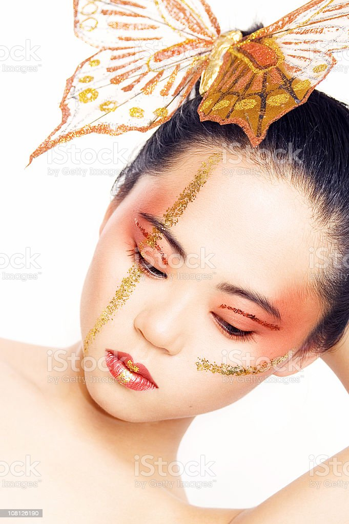 Young Asian Woman Wearing Butterfly in Hair royalty-free stock photo