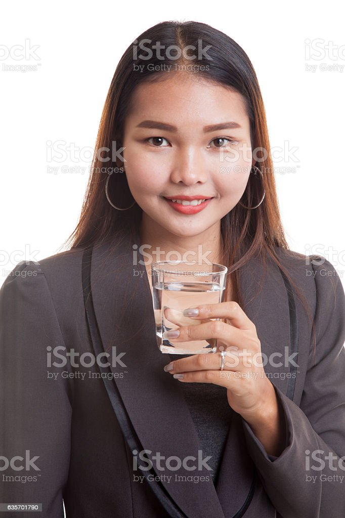 Young Asian woman with a glass of drinking water. royalty-free stock photo