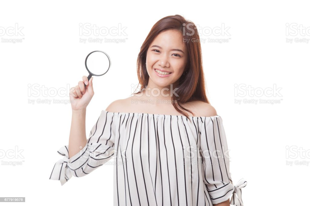 Young Asian woman with a magnifying glass. royalty-free stock photo