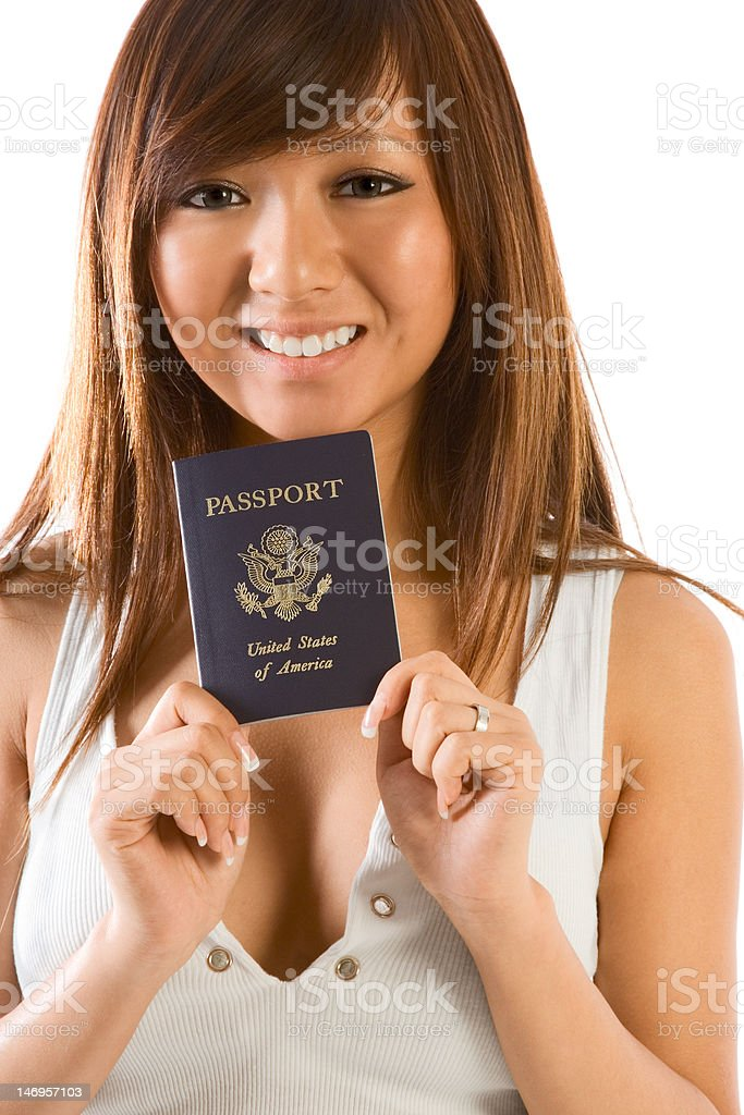 Young Asian woman with American passport in hand royalty-free stock photo
