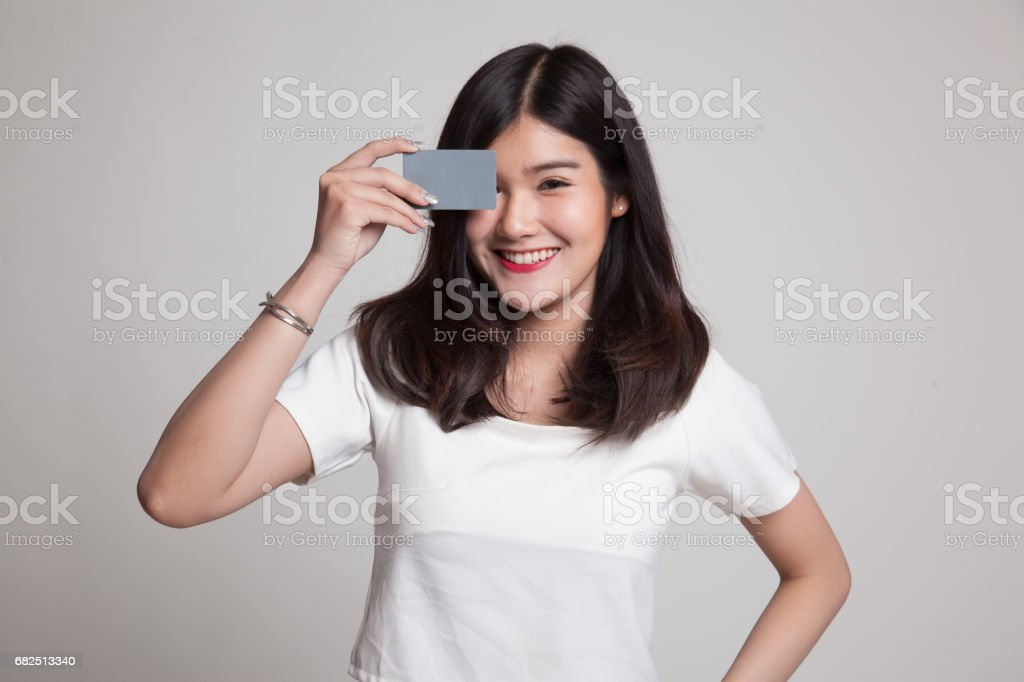 Young Asian woman with  blank card over her eye. Стоковые фото Стоковая фотография
