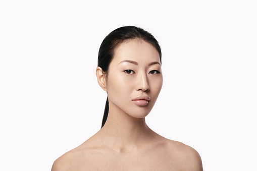 spa portrait of beautiful young asian woman on white background closeup. girl with clean skin