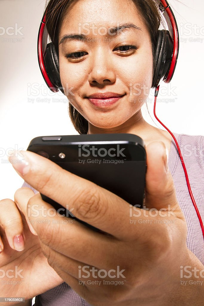 young asian woman with smartphone royalty-free stock photo
