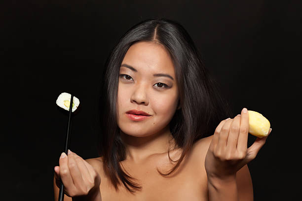 young asian woman with sushi and potato - naked women with animals stock photos and pictures