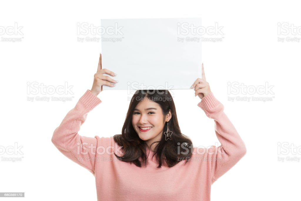 Young Asian woman with white blank sign. royalty-free stock photo