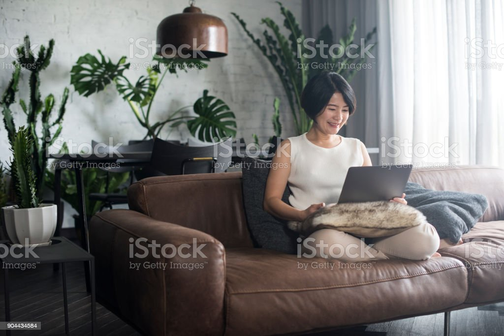 Young Asian woman working at home. stock photo