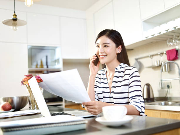 young asian woman working from home stock photo
