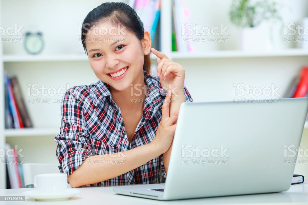 young asian woman working with laptop royalty-free stock photo