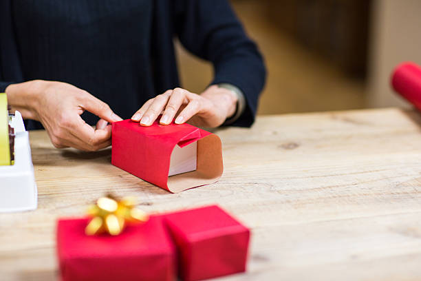 Young Asian Woman Wrapping a Gift stock photo