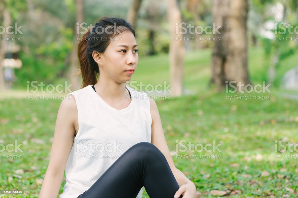 Young asian woman yoga outdoors keep calm and meditates while practicing yoga to explore the inner peace. Yoga and meditation have good benefits for health. Yoga Sport and Healthy lifestyle concept. stock photo