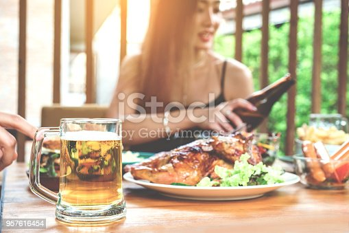 istock Young asian women drinking beer and clink glasses happy while enjoying home party 957616454