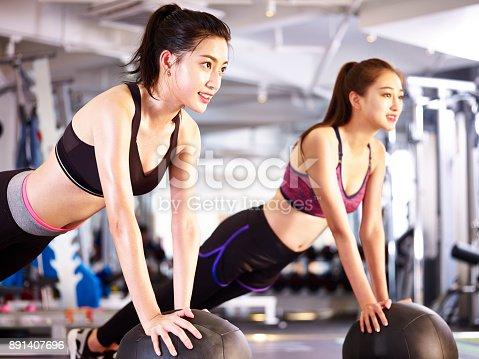 istock young asian women in aerobics class 891407696