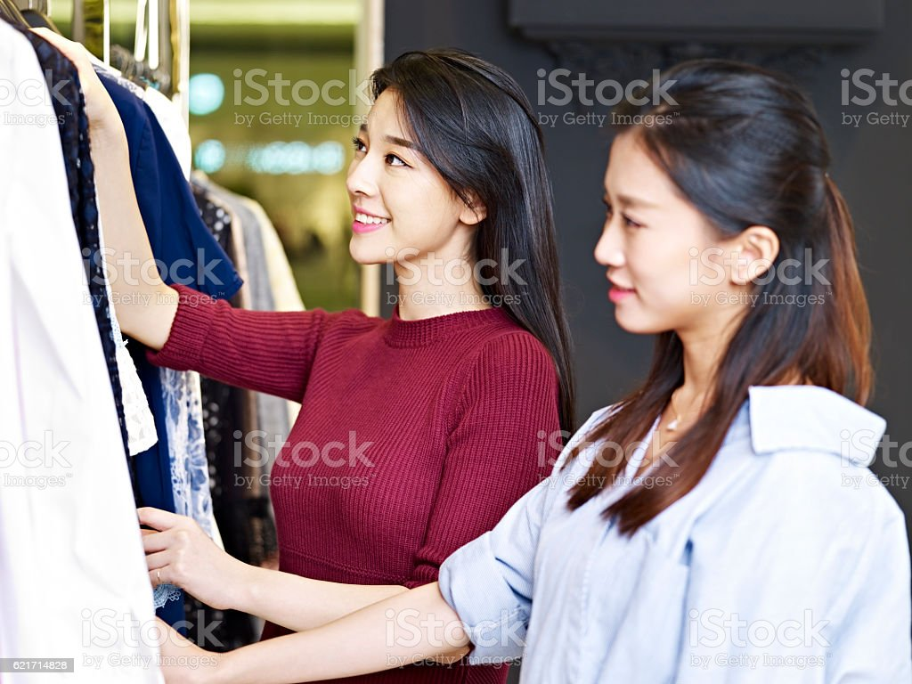 young asian women in clothing store ストックフォト