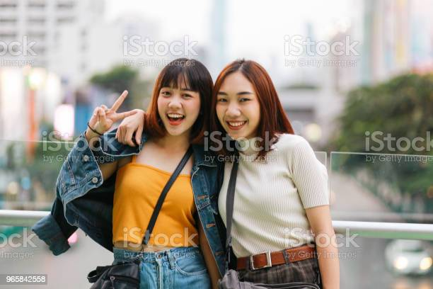 Young Asian Women Posing In Bangkok Going Shopping Together Having Fun Stock Photo - Download Image Now