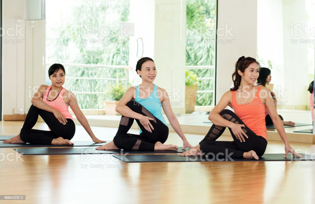 Young asian women practicing yoga meditation, healthy lifestyle, wellness, well being stock photo