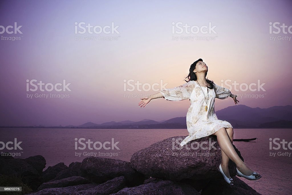 young asian women relax on rock royalty-free stock photo