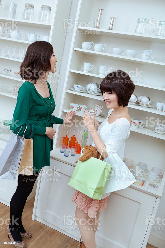 Young Asian Women Shoppers Shopping for Dishes in Retail Store royalty-free stock photo