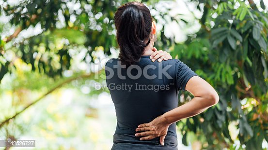 Young Asian women with back pain, health care concept