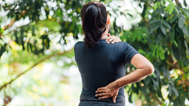 Young Asian women with back pain, health care concept Young Asian women with back pain, health care concept back pain stock pictures, royalty-free photos & images