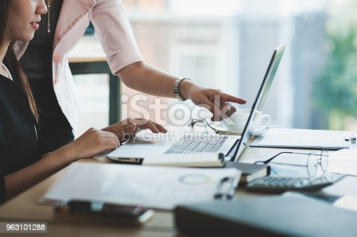 istock Young Asian women workers working together in office 963101288