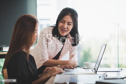 istock Young Asian women workers working together in office 963101296