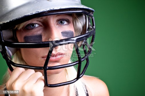 istock young atheletic woman basball helmet 157638068