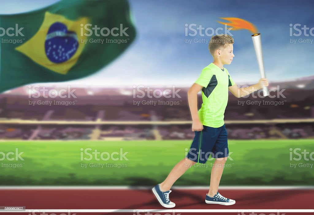 Young athlete boy with sport torch bearer running stock photo