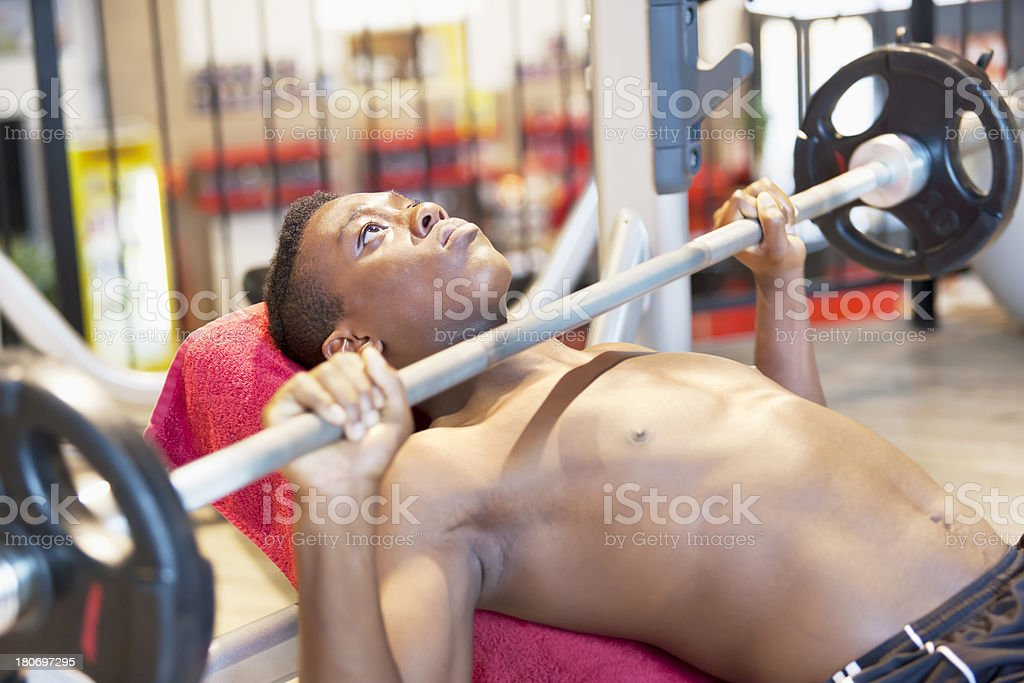 Young athlete doing bench press stock photo