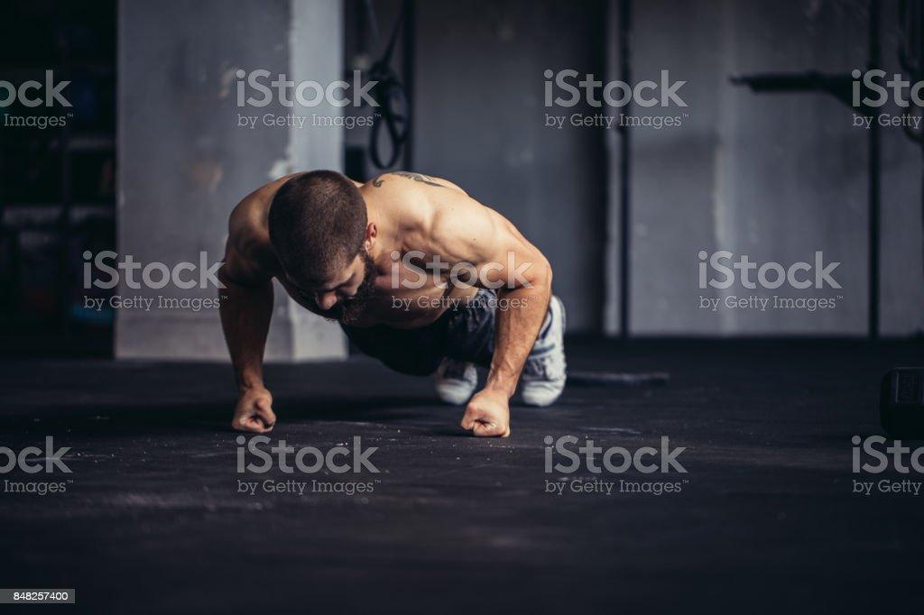 Young athlete doing push-ups stock photo