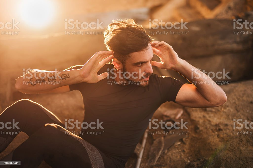 Young athlete doing sit-ups in a ruin. royalty-free stock photo