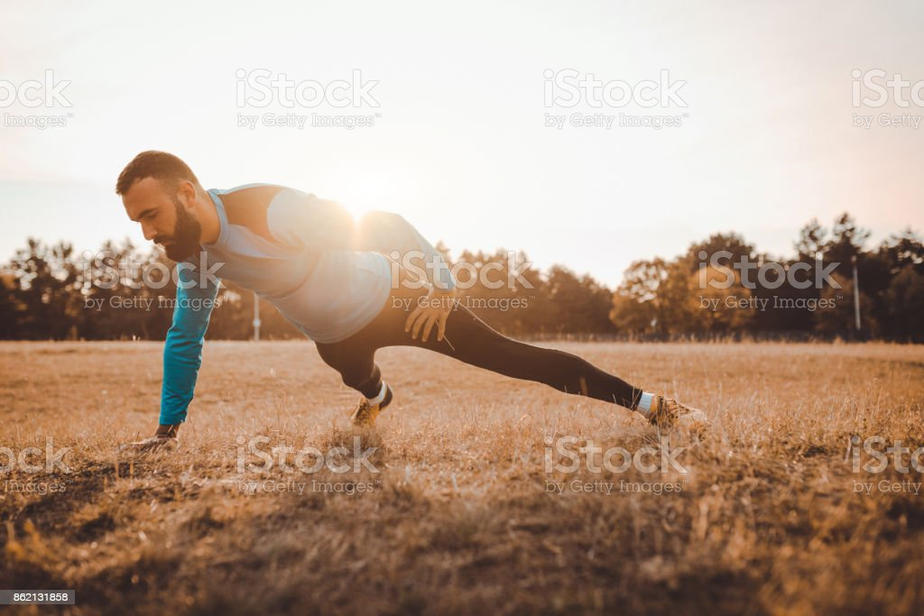 Young athlete exercising in the nature stock photo