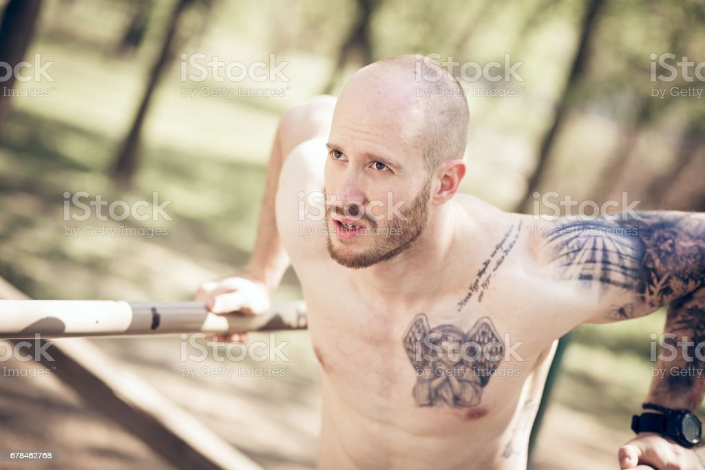 Young athlete exercising outdoor in the park royalty-free stock photo