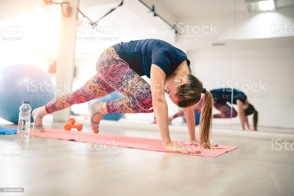 Young Athlete Female in Plank Pose doing Running Abs stock photo