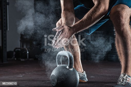 944655208 istock photo Young athlete getting ready for training 982358210