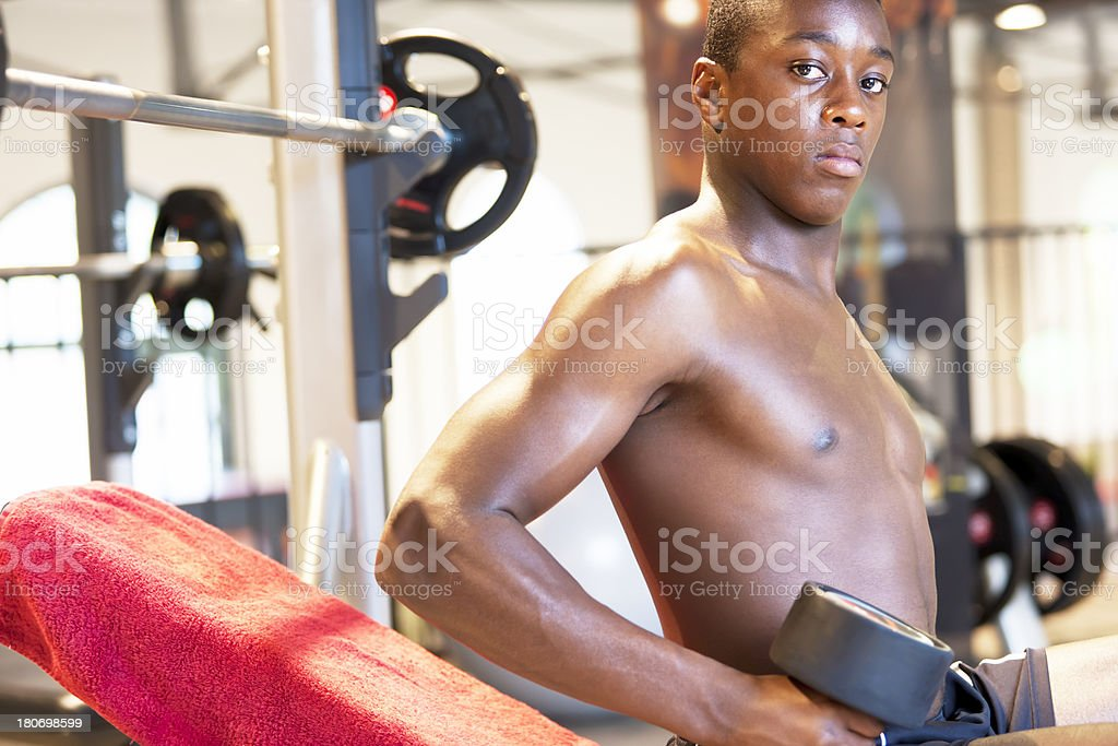 Young athlete holding dumbbell stock photo