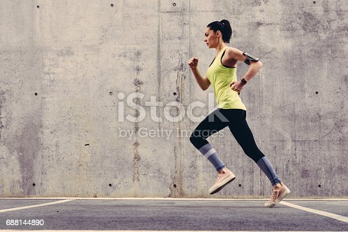 istock Young athlete jogging outside 688144890