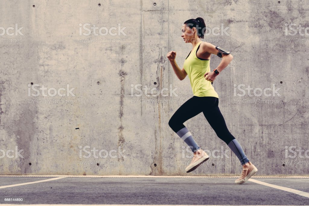 Young athlete jogging outside stock photo
