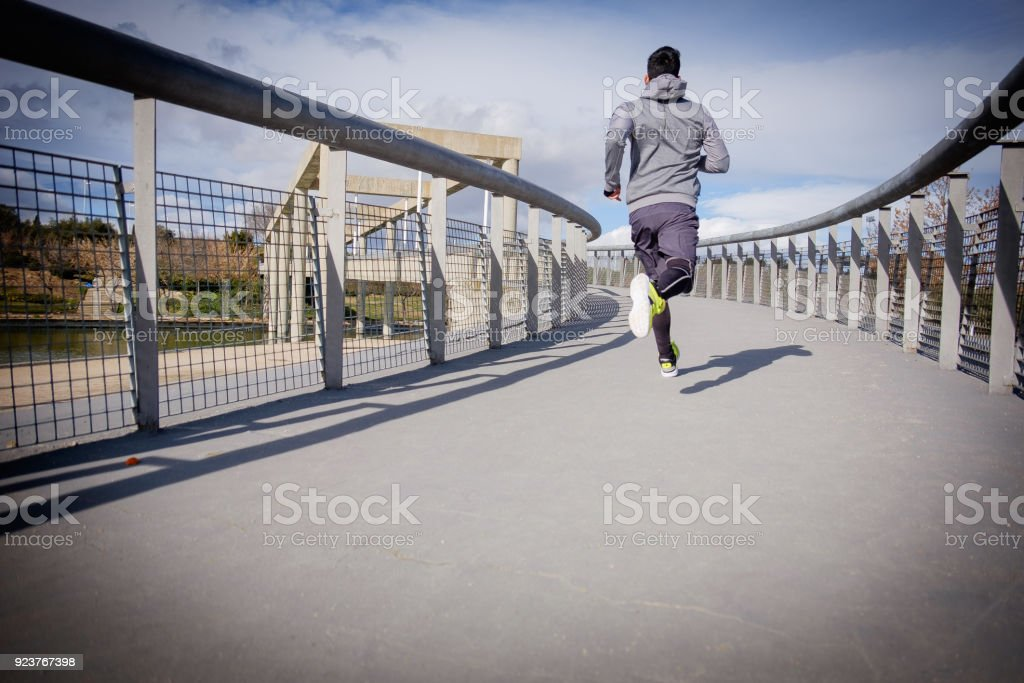 Young athlete man is doing sport runing stock photo