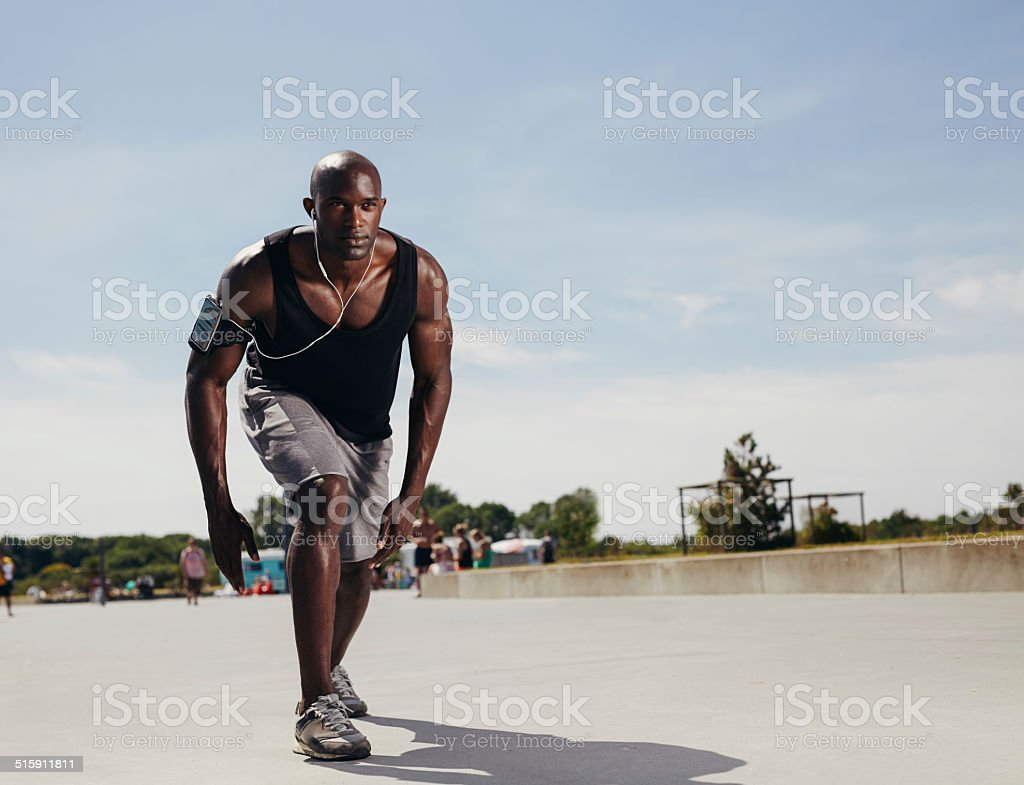 Young athlete on his mark to start a run stock photo