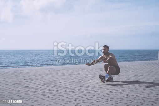 Young athlete practicing pistol squats outdoors