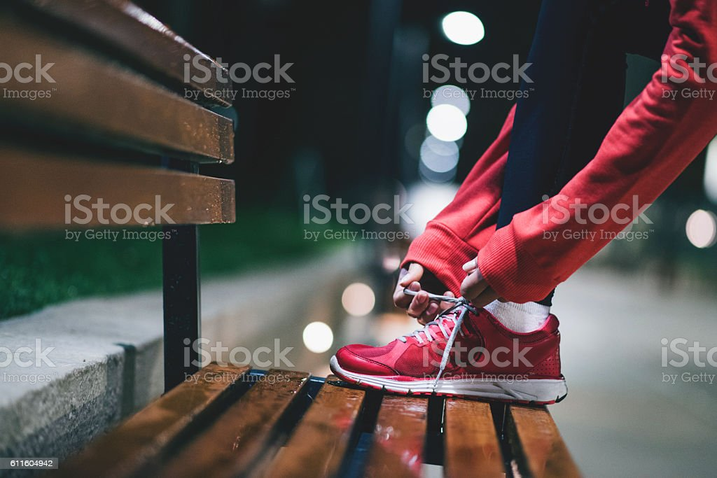 Young athlete preparing for long exercise stock photo