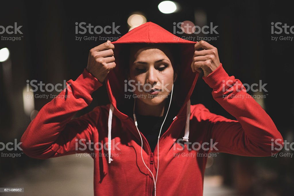 Young athlete starting her workout at night stock photo