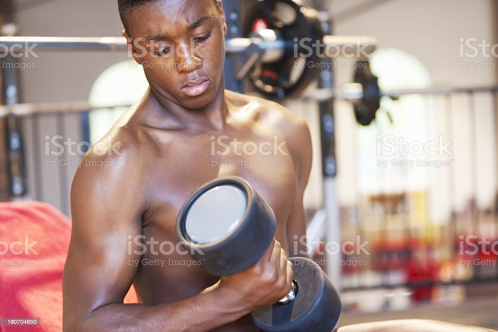 Young athlete training biceps stock photo