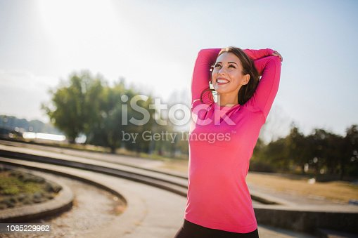 Photo of young woman stretching before exercise in the morning