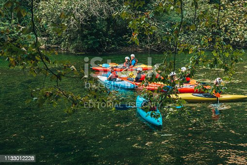 Fontaine-de-Vaucluse, Provence-Alpes-Cote d'Azur/France - September 26, 2018: Young athletes are floating on the river in a canoe