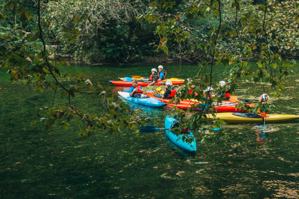 Fontaine-de-Vaucluse, Provence-Alpes-Cote d'Azur/France - September 26, 2018: Young athletes are floating on the river in a canoe stock photo