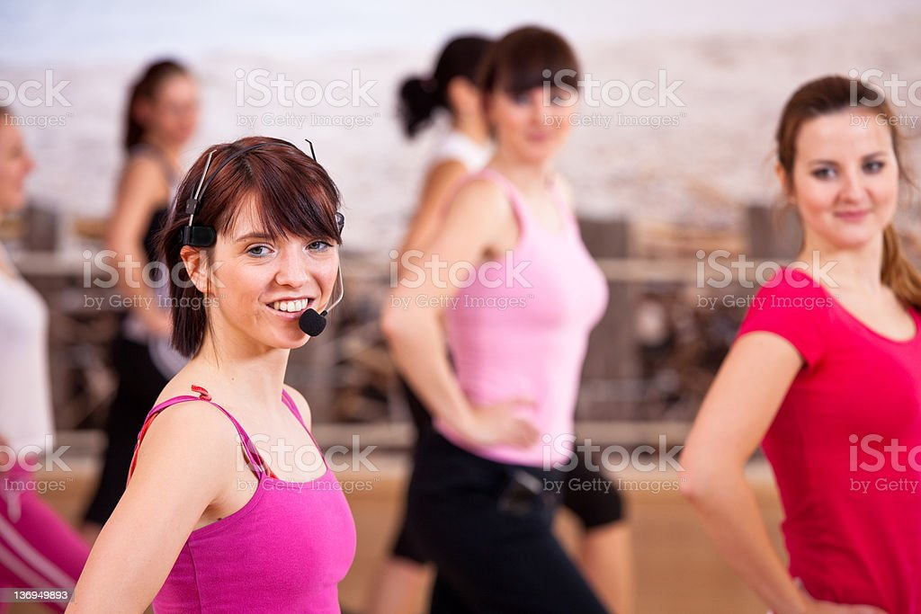 Young athletes exercasing in gym with trainer royalty-free stock photo